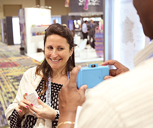 C&A Marketing's Steven Howcott showed Esthelle Philippe of Lorience France how far today's instant camera has come.